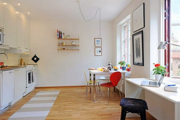 long brown striped area rug in front of white open kitchen concept for small apartment space idea